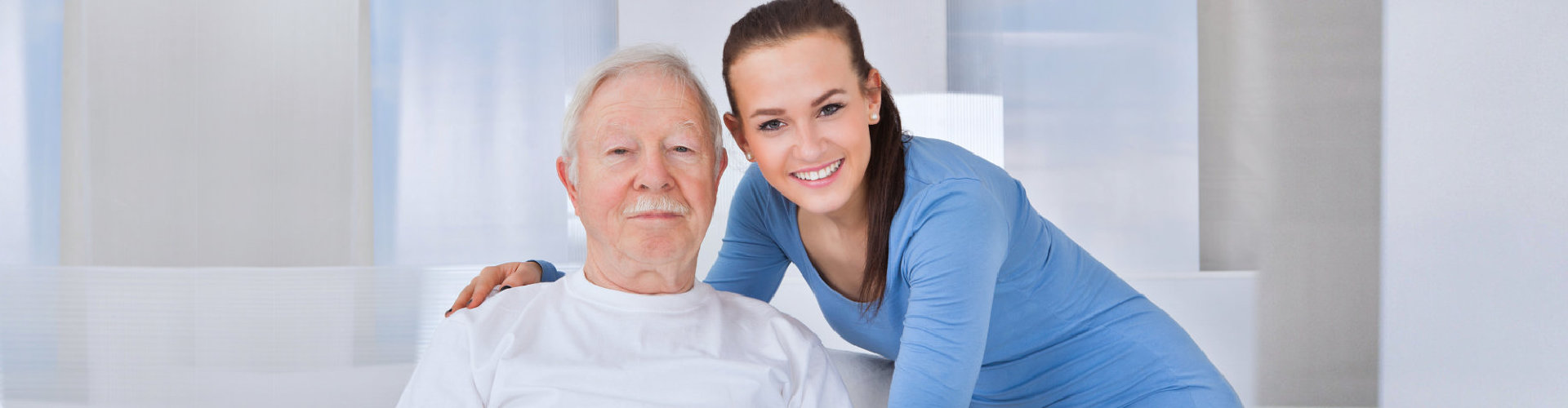 smiling young female with her grand father